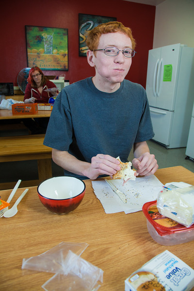"""Freshman computer science major Andrew Layton eats a late breakfast in the Skarland Hall communal kitchen while the Commons was closed during Spring Break.  <div class=""""ss-paypal-button"""">Filename: LIF-12-3322-036.jpg</div><div class=""""ss-paypal-button-end"""" style=""""""""></div>"""