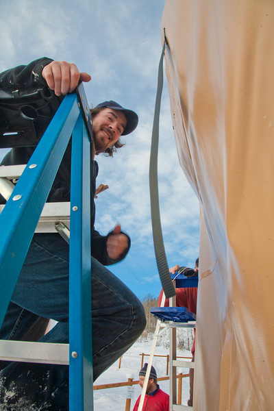 "Art major Bryson DeRonde lends a helping hand during the installation of a yurt set up next to the outdoor climbing wall by the SRC. The structure will serve as a warm-up hut and to store safety gear.  <div class=""ss-paypal-button"">Filename: LIF-12-3287-06.jpg</div><div class=""ss-paypal-button-end"" style=""""></div>"