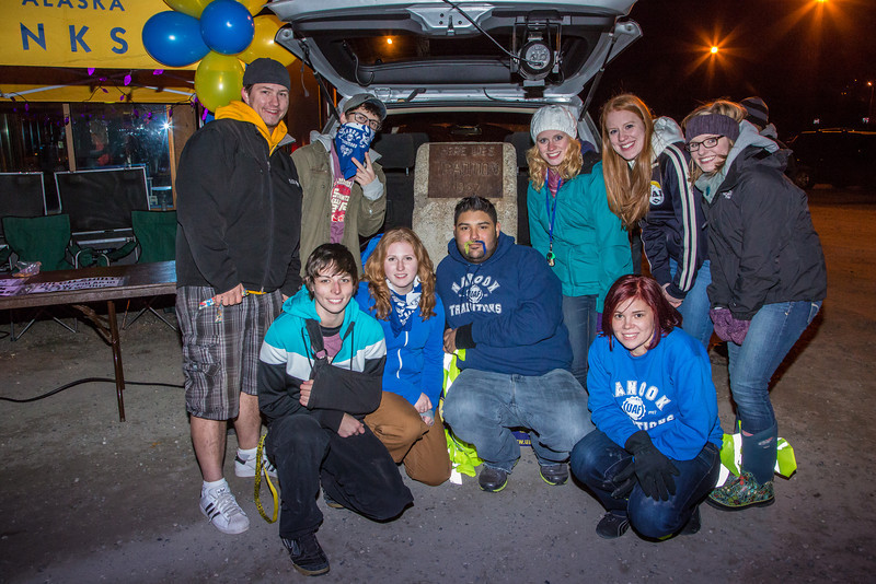 """A group of student leaders pose with the UAF tradition stone during its appearance at the 2012 Starvation Gulch bonfires.  <div class=""""ss-paypal-button"""">Filename: LIF-12-3571-023.jpg</div><div class=""""ss-paypal-button-end"""" style=""""""""></div>"""