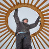 "Sam Braband, outdoor facilities manager with UAF's Department of Recreation, Adventure and Wellness, prepares to mount some hardware during construction of a yurt at the top of the new terrain park.  <div class=""ss-paypal-button"">Filename: LIF-13-3691-15.jpg</div><div class=""ss-paypal-button-end"" style=""""></div>"