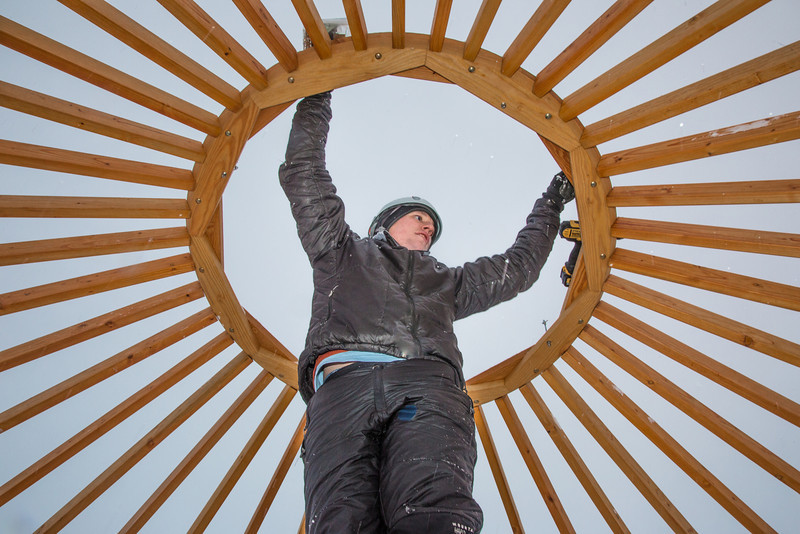 """Sam Braband, outdoor facilities manager with UAF's Department of Recreation, Adventure and Wellness, prepares to mount some hardware during construction of a yurt at the top of the new terrain park.  <div class=""""ss-paypal-button"""">Filename: LIF-13-3691-15.jpg</div><div class=""""ss-paypal-button-end"""" style=""""""""></div>"""