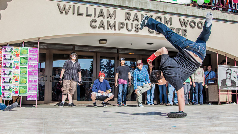 """Dancers help kick off the annual SpringFest celebration in front of the Wood Center.  <div class=""""ss-paypal-button"""">Filename: LIF-12-3373-124.jpg</div><div class=""""ss-paypal-button-end"""" style=""""""""></div>"""