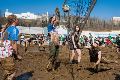 Participants in UAF's SpringFest activities get down and dirty in the mud volleyball games on the Fairbanks campus.  Filename: LIF-12-3376-93.jpg