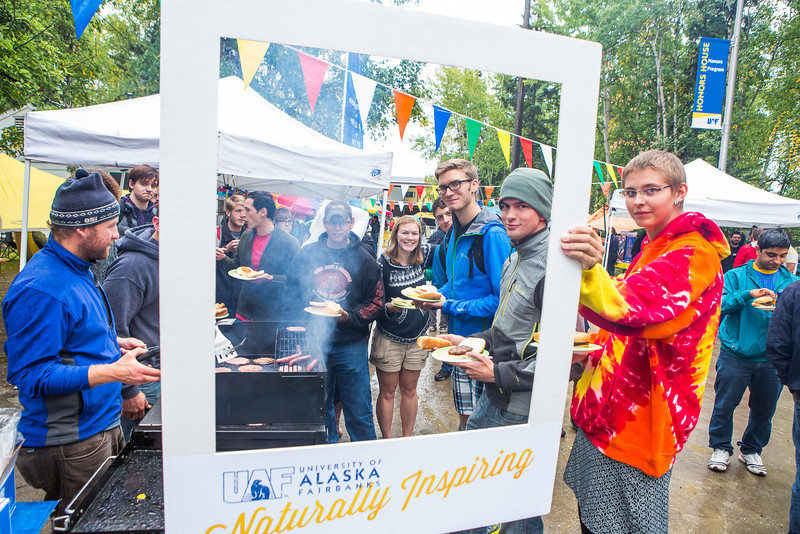 """Students bather around the grill at a block party sponsored by Student Activities Office at Copper Lane.  <div class=""""ss-paypal-button"""">Filename: LIF-13-3932-113.jpg</div><div class=""""ss-paypal-button-end"""" style=""""""""></div>"""