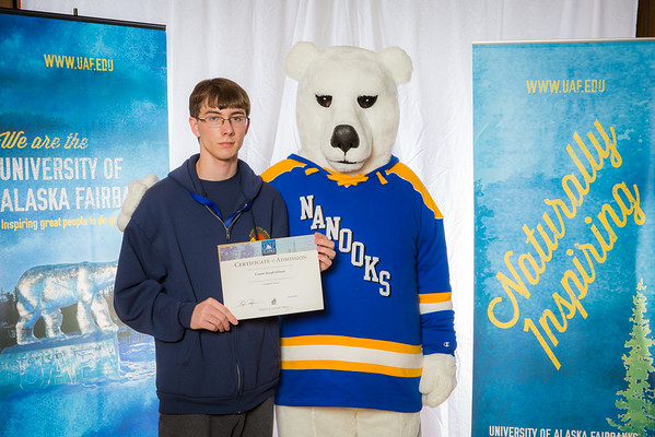 """Prospective students pose with the UAF mascot during the Fall 2015 Inside Out event hosted by UAF's office of admissions and the registrar.  <div class=""""ss-paypal-button"""">Filename: LIF-14-4353-87.jpg</div><div class=""""ss-paypal-button-end""""></div>"""