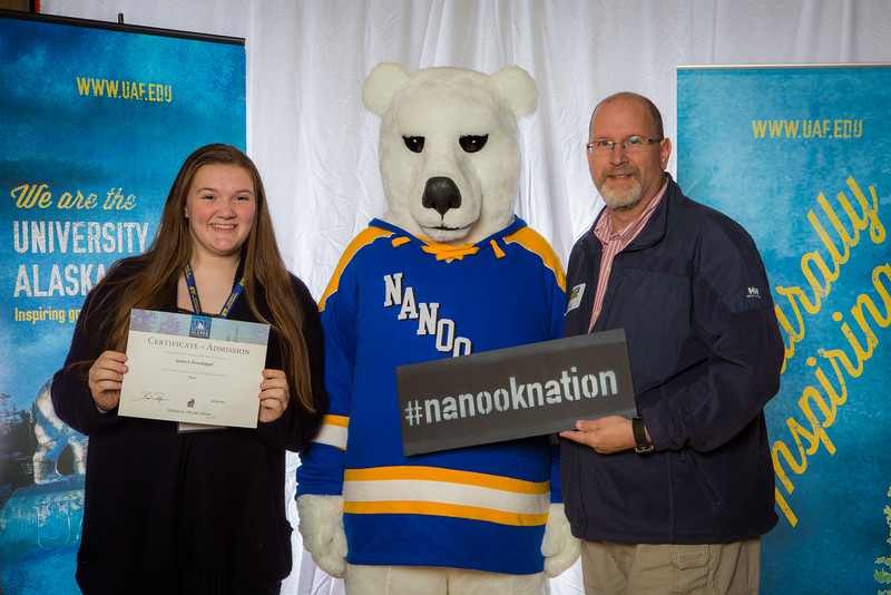 """Parents and prospective students pose with the UAF mascot during the Fall 2015 Inside Out event hosted by UAF's office of admissions and the registrar.  <div class=""""ss-paypal-button"""">Filename: LIF-14-4353-67.jpg</div><div class=""""ss-paypal-button-end""""></div>"""