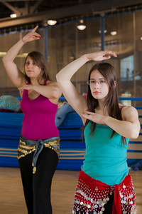(left to right) Heather Butler and Ellen Mitchell learn how to middle eastern dance in one of the recreation classes offered at the student rec center on campus.  Filename: LIF-11-3194-36.jpg