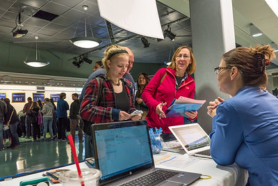 Returning students, staff and parents all pitch in to help new arrivals move into the residence halls during Rev It Up on the Fairbanks campus at the beginning of the fall 2015 semester.  Filename: LIF-15-4637-14.jpg
