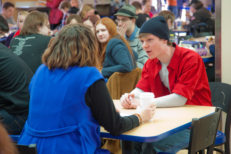"""Stephanie Sundberg, left, and Tyler McClendon perform a little """"flash theater"""" by running a scene from Theatre UAF's production of """"All in the Timing"""" during a busy time in the Wood Center food court.  <div class=""""ss-paypal-button"""">Filename: LIF-12-3325-34.jpg</div><div class=""""ss-paypal-button-end"""" style=""""""""></div>"""