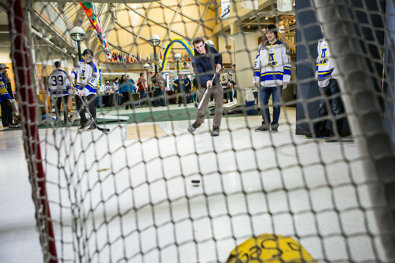 """Students test their hockey skills during the Keep the Cup PreParty rally at the Wood Center.  <div class=""""ss-paypal-button"""">Filename: LIF-14-4103-32.jpg</div><div class=""""ss-paypal-button-end""""></div>"""