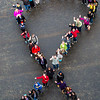 """Faculty, students and staff organize a human ribbon on campus for Autism Awareness Month.  <div class=""""ss-paypal-button"""">Filename: LIF-16-4861-64.jpg</div><div class=""""ss-paypal-button-end""""></div>"""