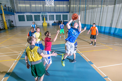 Intramural basketball action on a Tuesday night at the Student Recreation Center.  Filename: LIF-14-4111-327.jpg