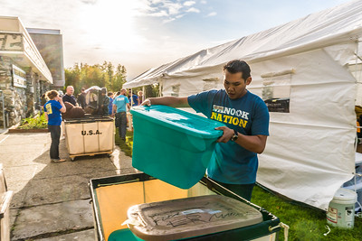 Returning students, staff and parents all pitch in to help new arrivals move into the residence halls during Rev It Up on the Fairbanks campus at the beginning of the fall 2015 semester.  Filename: LIF-15-4637-66.jpg