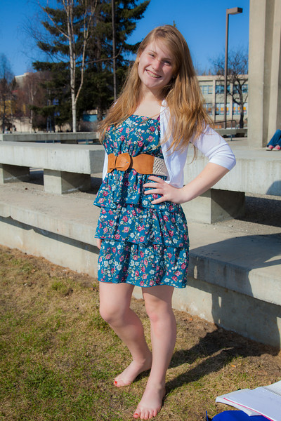 """Kaylee Miltersen goes barefoot while enjoying some nice weather outside on campus after a long winter.  <div class=""""ss-paypal-button"""">Filename: LIF-12-3356-73.jpg</div><div class=""""ss-paypal-button-end"""" style=""""""""></div>"""