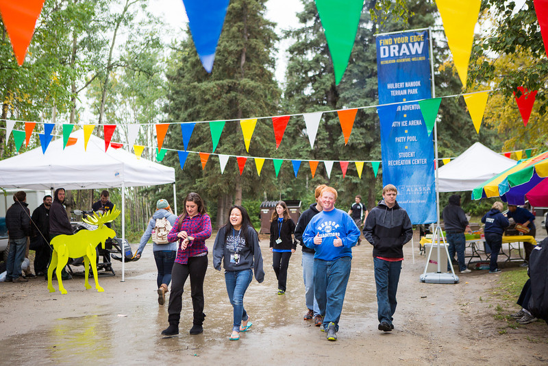 "Students arrive for the Student Activities Office-sponsored block party at Copper Lane at the Fall of 2013.  <div class=""ss-paypal-button"">Filename: LIF-13-3932-5.jpg</div><div class=""ss-paypal-button-end"" style=""""></div>"