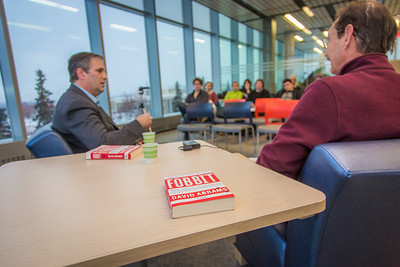 Author and UAF alum David Abrams, left, visits with professor emeritus Frank Soos and students about his new book, Fobbit, and other topics during a Midnight Sun Visiting Writers craft talk in the Murie Building Nov. 8.  Filename: LIF-13-3999-124.jpg