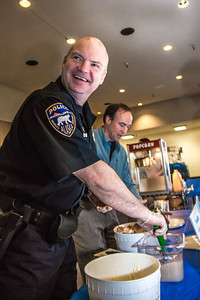 UAF police chief Sean McGee joined the crew serving free ice cream following Chancellor Rogers 2012 convocation address.  Filename: LIF-12-3545-95.jpg