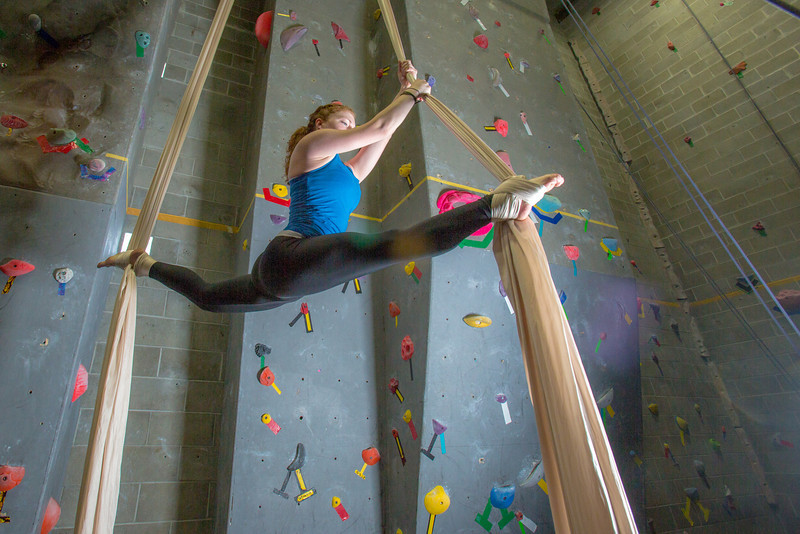 """Miriam Brooks practices her silk climbing skills on the climbing wall in the SRC.  <div class=""""ss-paypal-button"""">Filename: LIF-13-3819-33.jpg</div><div class=""""ss-paypal-button-end"""" style=""""""""></div>"""