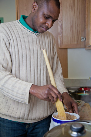 Peter Ikewun, a petroleum engineeering graduate student from Nigeria, prepares a traditional African soup in his communal Wickersham Hall kitchen.  Filename: LIF-12-3268-146.jpg