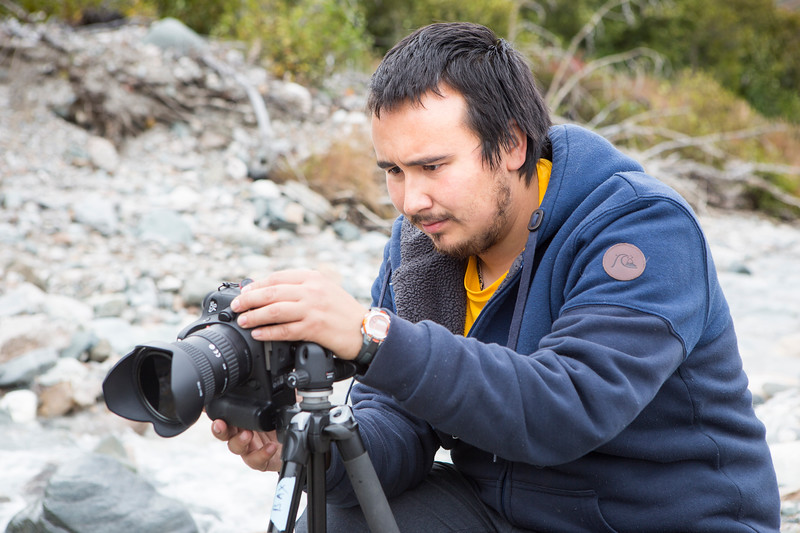 """Baxter Bond adjusts his camera settings and composes his image in Whistler Creek for the Frozen Lenses Landscape Photography Workshop he led on Saturday, Sept. 15, 2018.  <div class=""""ss-paypal-button"""">Filename: LIF-18-5931-81.jpg</div><div class=""""ss-paypal-button-end""""></div>"""