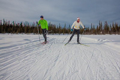 UAF students Ian Wilkinson and Raphaela Sieber enjoy a morning loop around the campus ski trails.  Filename: LIF-12-3348-57.jpg