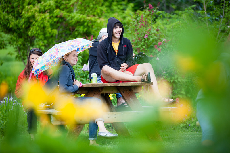 """Chris Cioffi is all smiles after the weather turned for the worst during Summer Sessions' Music in the Garden series at the Georgeson Botanical Garden.  <div class=""""ss-paypal-button"""">Filename: LIF-12-3437-63.jpg</div><div class=""""ss-paypal-button-end"""" style=""""""""></div>"""