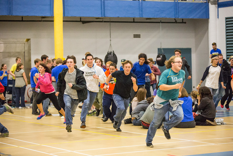 """And they're off! Incoming students participating in a scavenger hunt run toward their group to find an item during New Student Orientation at the Student Rec. Center.  <div class=""""ss-paypal-button"""">Filename: LIF-13-3924-212.jpg</div><div class=""""ss-paypal-button-end"""" style=""""""""></div>"""