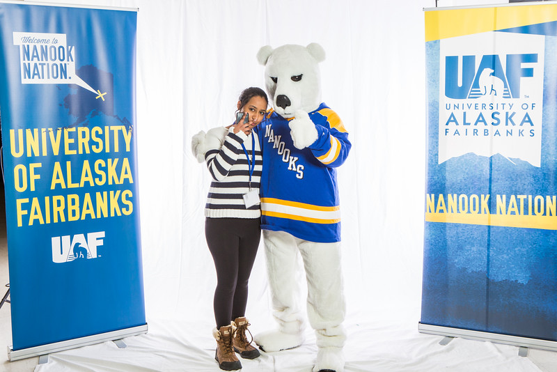 """Future UAF students and family members pose with the Nanook mascot during Inside Out.  <div class=""""ss-paypal-button"""">Filename: LIF-16-4839-55.jpg</div><div class=""""ss-paypal-button-end""""></div>"""