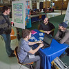 "Wyatt Hurlbut, seated left behind table, and Brett Parks, board members for UAF's Office of Sustainability, solicit input into a proposed super energy efficient ""sustainable village"" under consideration for construction on the Fairbanks campus.  <div class=""ss-paypal-button"">Filename: LIF-11-3214-20.jpg</div><div class=""ss-paypal-button-end"" style=""""></div>"