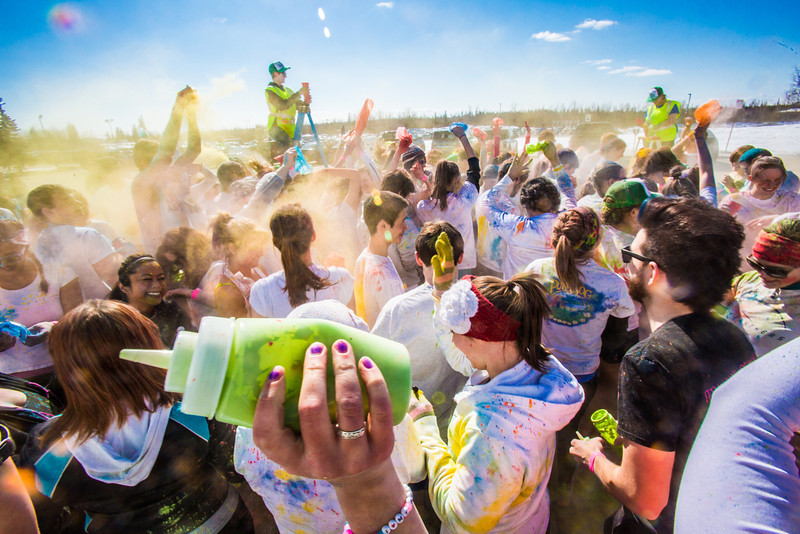 """Students enjoy getting doused with colored dye before participating in a 5-kilometer run during SpringFest on the Fairbanks campus.  <div class=""""ss-paypal-button"""">Filename: LIF-13-3805-74.jpg</div><div class=""""ss-paypal-button-end"""" style=""""""""></div>"""