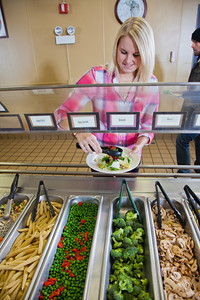 Junior Chelsea Fillingim loads up on vegetables during lunch in the Lola Tilly Commons.  Filename: LIF-11-3220-039.jpg