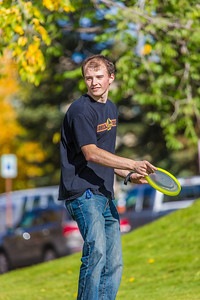 Engineering major Philip White takes time between classes to play with a frisbee on a beautiful September afternoon on the Fairbanks campus.  Filename: LIF-13-3934-66.jpg