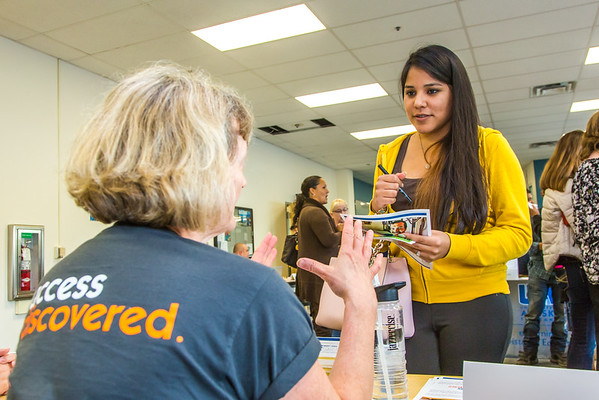 """Staff members turn out to answer community members' questions during the UAF Community and Technical College's (CTC) fall semester round up.  <div class=""""ss-paypal-button"""">Filename: LIF-15-4619-25.jpg</div><div class=""""ss-paypal-button-end""""></div>"""