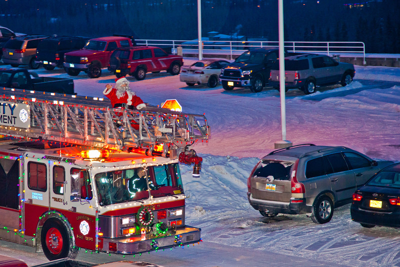 "Santa Claus made his annual rounds to various locations on the Fairbanks campus riding atop a University Fire Department truck a couple days before Christmas.  <div class=""ss-paypal-button"">Filename: LIF-11-3249-27.jpg</div><div class=""ss-paypal-button-end"" style=""""></div>"