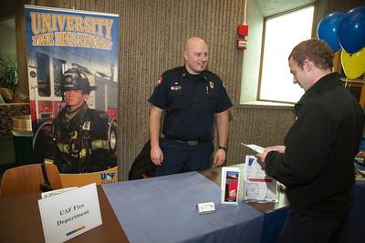 UAF student Ethan Stevenson talks to Captain Forrest Kuiper at the student job fair in the Wood Center.  Filename: LIF-12-3311-13.jpg