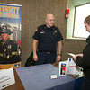 "UAF student Ethan Stevenson talks to Captain Forrest Kuiper at the student job fair in the Wood Center.  <div class=""ss-paypal-button"">Filename: LIF-12-3311-13.jpg</div><div class=""ss-paypal-button-end"" style=""""></div>"