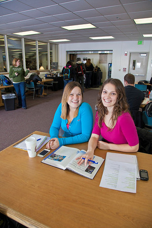 UAF students Megan Gilmore and Ashley Bartolowits sit with their cofee and study materials in the 24-hour study area of the Rasmuson Library.  Filename: LIF-11-3212-139.jpg