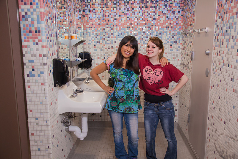 "Skarland Hall residents Sara Spindler, left, and Hailley Myers get ready for a day of classes in one of the dorm's newly re-modeled bathrooms.  <div class=""ss-paypal-button"">Filename: LIF-12-3322-156.jpg</div><div class=""ss-paypal-button-end"" style=""""></div>"