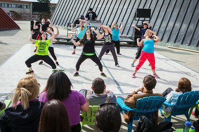 Students dance on a makeshift dancefloor on the Wood Center deck during Spring Fest.  Filename: LIF-14-4161-41.jpg