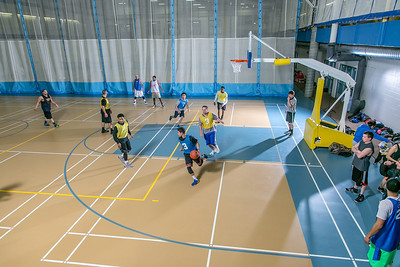 Intramural basketball action on a Tuesday night at the Student Recreation Center.  Filename: LIF-14-4111-304.jpg