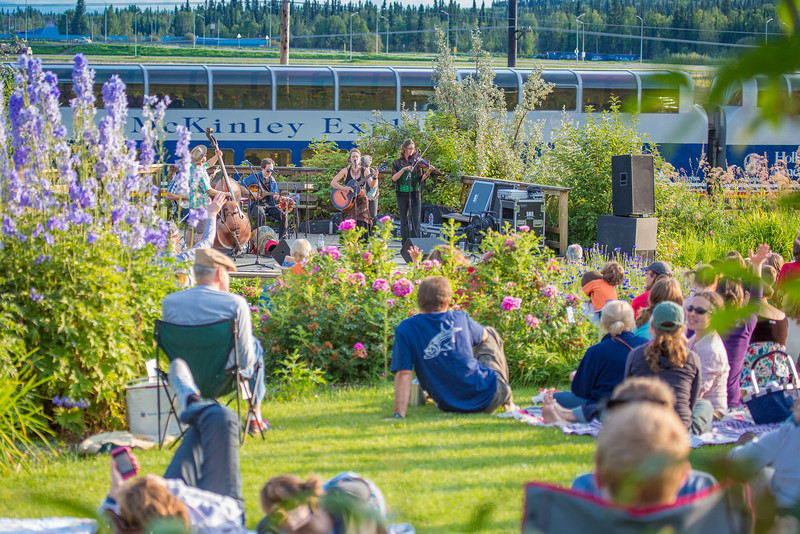 """The local Fairbanks band Zingaro Roots performed before an appreciative audience during one of the Concert in the Garden events sponsored by UAF Summer Sessions.  <div class=""""ss-paypal-button"""">Filename: LIF-12-3489-143.jpg</div><div class=""""ss-paypal-button-end"""" style=""""""""></div>"""