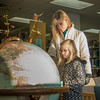 "Jaimee Coon points out some features on the globe while visiting the Rasmuson Library with her third grade daughter Amaya.  <div class=""ss-paypal-button"">Filename: LIF-14-4045-105.jpg</div><div class=""ss-paypal-button-end"" style=""""></div>"