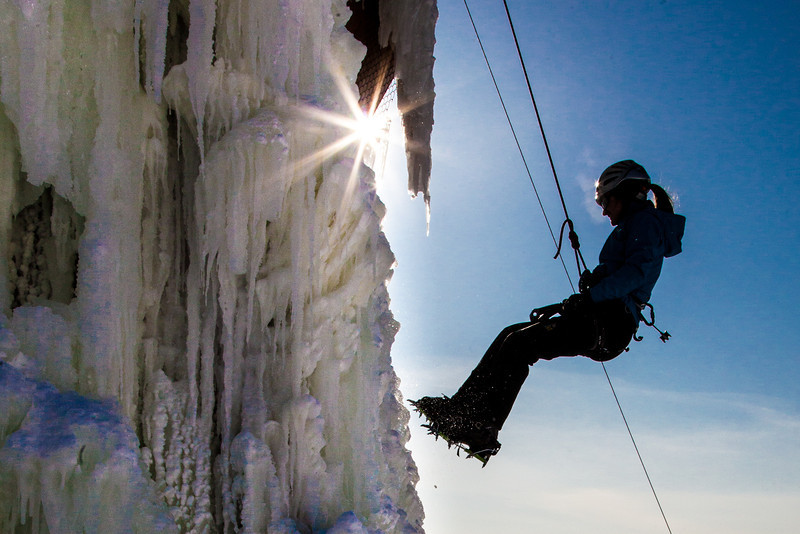 """Students take advantage of nice spring weather to try out their climbing skills on the new ice wall near the SRC.  <div class=""""ss-paypal-button"""">Filename: LIF-12-3321-027.jpg</div><div class=""""ss-paypal-button-end"""" style=""""""""></div>"""