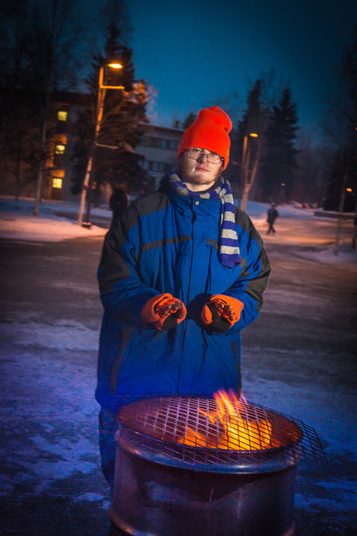 """Mathew Carrick take his turn at the Honors Program homeless vigil Friday morning while the temperature hovered around -20°.  <div class=""""ss-paypal-button"""">Filename: LIF-12-3653-66.jpg</div><div class=""""ss-paypal-button-end"""" style=""""""""></div>"""