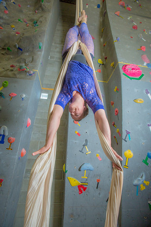 Graduate student Stephany Jeffers practices her silk climbing skills in the SRC.  Filename: LIF-13-3819-29.jpg
