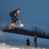 """Students take advantage of some free time during finals week to try out their modified ski-bike on the hill below the IAB greenhouse.  <div class=""""ss-paypal-button"""">Filename: LIF-11-3246-46.jpg</div><div class=""""ss-paypal-button-end"""" style=""""""""></div>"""