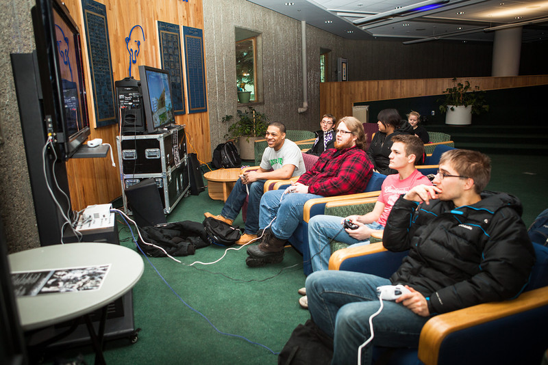 """Gamers battle it out through video games provided by the Student Activities Office at the  third annual 2012 Pop Con event Nov. 2012.  <div class=""""ss-paypal-button"""">Filename: LIF-12-3640-3.jpg</div><div class=""""ss-paypal-button-end"""" style=""""""""></div>"""