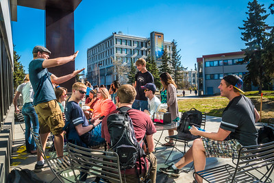 Students enjoy some spring sunshine and warm temperatures in late April on the Fairbanks campus.  Filename: LIF-16-4877-29.jpg