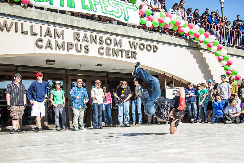 """Dancers help kick off the annual SpringFest celebration in front of the Wood Center.  <div class=""""ss-paypal-button"""">Filename: LIF-12-3373-093.jpg</div><div class=""""ss-paypal-button-end"""" style=""""""""></div>"""
