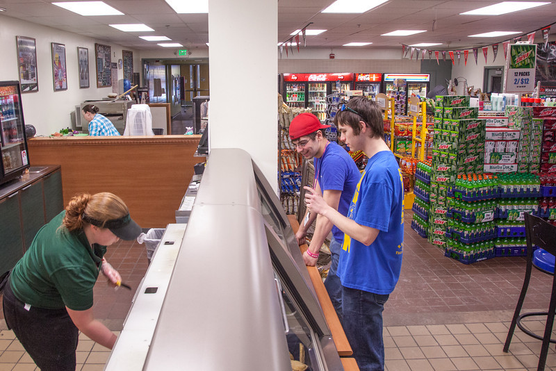 "Students Robert Doerning and Quinn Verfaillie order sandwiches in the Campus Cache, located in the Moore-Bartlett-Skarland residence hall complex on the Fairbanks campus.  <div class=""ss-paypal-button"">Filename: LIF-12-3339-19.jpg</div><div class=""ss-paypal-button-end"" style=""""></div>"